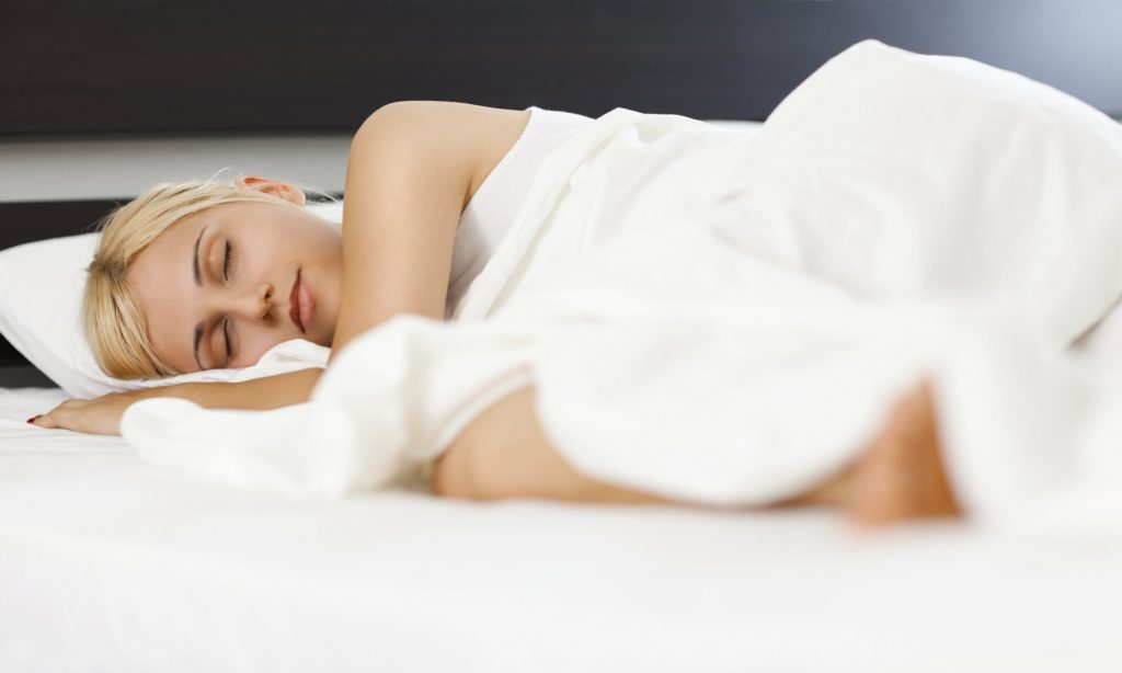 Woman-asleep-in-bed-The-Sleep-Council-1
